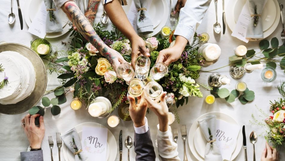 people-cling-wine-glasses-on-wedding-reception-PP2NYNT
